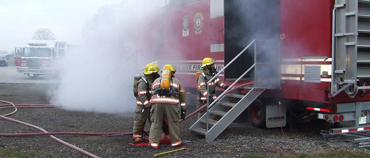 Firefighters performing training exercise at training trailer